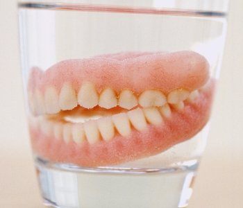 dentures in glass of watter, Thirty-Two Dental