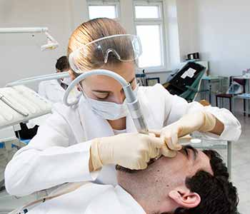 Image of a Dentist cleaning a Root Canal
